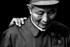 (Nocturnales) Tags: china portrait bw soldier beijing communist forbiddencity veteran tiananmen peking littlestories fivestarsgallery picswithsoul mikaelmarguerie