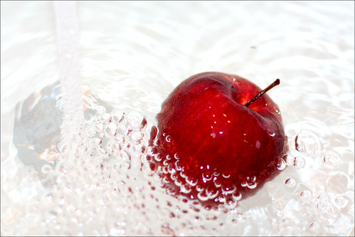Washing red apple
