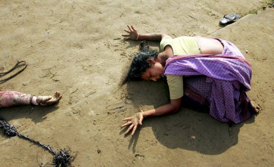An Indian woman mourns the death of a relative killed in the Asian Tsunami