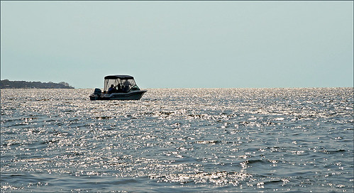 single boat on the Great South Bay by Alida's Photos