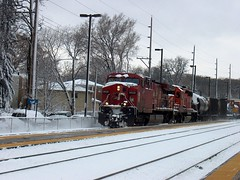 Eastbound Canadian Pacific freight train passing through Christmas card scenery. Photographed at the northwest suburban Metra River Grove Illinois commuter rail station.