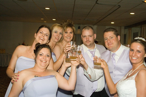 The Bride, Bride's Maids, and some Grooms' Men share a shot