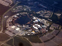 Epcot Center from Above - Disney World (garyhymes) Tags: vacation lake cars water plane buildings circle flying photo orlando epcot pond parkinglot florida aircraft awesome parking flight disney mickey aerial resort airline amusementpark sarasota wdw waltdisneyworld takeoff epcotcenter flyover mco windowseat flyby airtran suntran climbout travelerphotos