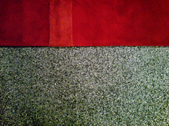 Red rug on stone carpet