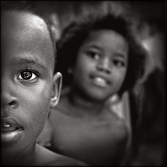 An eye on violence... (carf) Tags: poverty girls boy brazil bw boys girl brasil sepia kids children hope blackwhite kid community support child risk pablo forsakenpeople esperana social impoverished underprivileged afrobrazilian altruism eldorado shanty superfantastique favela development prevention flvia atrisk mundouno artlibre