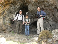 Tony, David, and Steve checking out some small caves in a rock formation