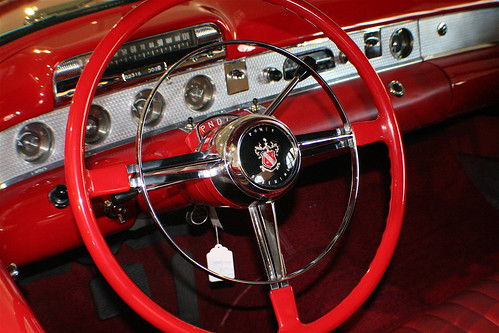 Red Motorcar Steering Wheel and Dashboard