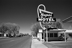 route 66. seligman, az. 2007. (eyetwist) Tags: road arizona bw usa film monochrome sign analog america blackwhite route66 nikon mother motel roadtrip ishootfilm 66 retro route americana arrow analogue roadside nikkor googie vacancy nikonf3 seligman supai 2007 redfilter photoimpact emulsion arrowsign efke motherroad us66 colortv efke100 r60 eyetwist fadingamerica f3t nikonf3t photoimpactwest 2850mmf35ais contactforstockusage