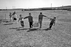 Mongolia- water bearers (luca marella) Tags: people bw white black children photo asia pb bn chain mongolia e balance bianco nero weight bearer marella bnpersone marellaluca