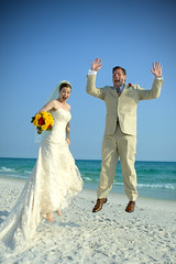 Go ahead, jump (wiseacre photo) Tags: wedding beach water happy groom bride seaside interestingness jump sand gulf dress florida joy suit leap cacontest