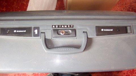 Suvarna Recording Asianet suitcase
