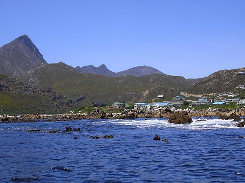 Rooiels from the sea. The mountains of the Kogelberg Nature Reserve rise green in the distance. The reserve is now a World Heritage Site.