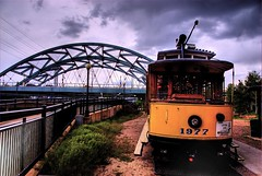 Trolley & Bridge, Denver, Colorado (Thad Roan - Bridgepix) Tags: bridge yellow clouds fence river colorado arch trolley steel bridges overcast arches denver lampost streetcar hdr bridging confluencepark blueribbonwinner 200705 southplatteriver photomatix bridgepixing speerblvdbridge bridgepix