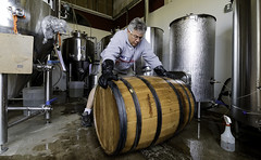 prepping the barrel (.sanden.) Tags: 10mm canon7dmarkii efs1018mm coloradosprings brewery working barrel man gloves co glasses tanks colorado business wet ground