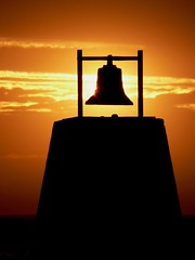 Ringing in the Evening (Mowling) Tags: sunset orange sun silhouette golden seaside glare bell dusk adelaide glowing southaustralia cairn centenary largsbay mowling shannonmowling
