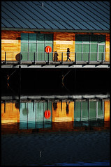 Commuter (tanera) Tags: red water shop contrast reflections river pier spring paint colours shadows dundee steps rails reflective barriers navigation waterline corrugated mainland corrugatediron anywhere outstanding wwwtaneracouk httptaneracouk