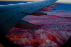 fire in the sky (Dmitry Gudkov) Tags: sunset 20d clouds plane pretty pair wing surreal fav sigma1850mm superhearts seasunclouds dmitrygudkovphotography wwwgudphotocom
