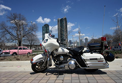 Police Harley, pink Checker and the CN Tower (scienceduck) Tags: pink toronto ontario canada public cntower wideangle harley harleydavidson motorcycle april checker tdot 2007 khalsa checkercab khalsaday policemotorcycle scienceduck