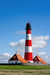 Lighthouse Westerhever (tobsen1981) Tags: ocean houses sea sun lighthouse house kite cold beach water weather st clouds strand germany landscape deutschland seaside sand scenery meer wasser view cloudy surfer h