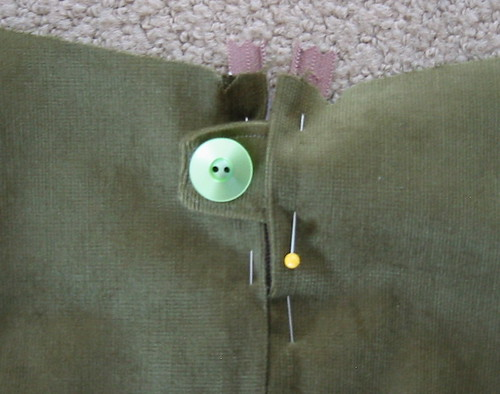 adding a little button tab to the back zipper