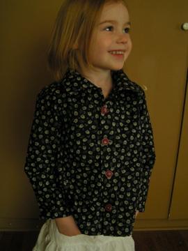 Little girl + owl shirt.
