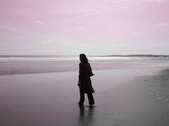 Her, walking by the beach (Semi-detached) Tags: pink light woman beach girl shot her alnwick northumberland northumbria alnmouth april 2007