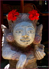 Hindu statue with red flowers (Franc Le Blanc .) Tags: bali flower statue indonesia asia culture hibiscus offering hindu breathtaking ubud canang