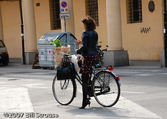on the go (Ascites29) Tags: travel italy woman bicycle cellphone skirt bologna heels groceries