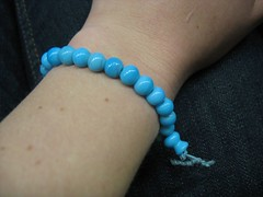 gum ball machine treasure (MargaretHall) Tags: seattle beads hand arm turquoise bracelet ballard wrist scar sunsetbowl may2007