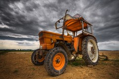 orange metal (Mace2000) Tags: sky orange tractor nature field clouds germany landscape deutschland 350d traktor fiat natur heavymetal machinery vehicle agriculture mutedcolors landschaft cloudjunkie hdr rheinlandpfalz yourewelcome mace2000 countryscenery 2img2558 thankyouasmundur youknowforwhat