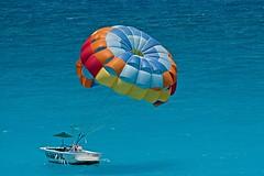 The colors of Cancun (Ricardo Carreon) Tags: ocean blue sea praia beach topf25 colors topv2222 mexico boat topf50 colorful turquoise playa colores explore topv5555 parasail cancun topv3333 topv4444 colorido topv6666 aplusphoto superhearts explore18may2007