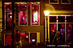 The red-light district of Amsterdam, The Netherlands (photongo) Tags: tourism netherlands dutch amsterdam sex thenetherlands landmark tourist prostitution capitalism society job redlightdistrict johns attraction hookers sexworkers dangngo