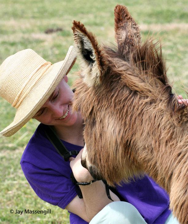 Elizabeth Ruffing with a miniature donkey