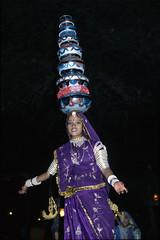 Dancer at Chowki Dhani, Jaipur, India (Rowan Castle) Tags: woman india castle film girl beautiful female night canon outdoors asia fuji indian traditional slide dancer pots balance rowan provia jaipur dhani rajasthan eos300 highquality 400f chowki 9india0021 flickrfinal