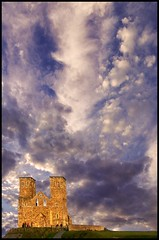 Skies over Reculver (adrians_art) Tags: blue light red england orange castles clouds buildings dark geotagged kent ruins bravo skies shadows dusk quality sunsets strongholds reculver geotags blueribbonwinner supershot magicdonkey abigfave impressedbeauty superaplus aplusphoto diamondclassphotographer bratanesque ultrashot