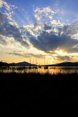 Wrthersee Sunset II (mgratzer) Tags: sunset sky sun lake color reflection boats eos austria evening cloudy ships carinthia strandbad klagenfurt whater wrthersee photobiking photocycling showonmysite