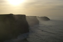 Cliffs of Mohr / Cliffs of Moher - Ireland's western coast (Christmas w/a K) Tags: ocean lighting county ireland light sunset sea irish cliff sun mist west nature misty fog backlight one 1 coast interestingness google hit interesting clare waves heart top first images eire cliffs diamond number explore coastal dh page western winner keywords cliffsofmoher popular 10000 cy finest moher contrejour natures naturesbest seaspray countyclare tenthousand googleimages clif keyword ire mohr cliffsofmohr cotcmostfavorited challengeyouwinner cywinner shieldofexcellence diamondheart