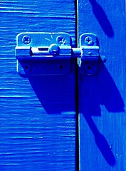 lock the blues out (Darwin Bell) Tags: blue lock monotone catch latch blueribbonwinner 50faves mywinners p1f1 tepasaste colorphotoaward superhearts colourartaward artlegacy