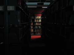 spotlit (emdot) Tags: light mystery dark library books spooky stacks intrigue librariesandlibrarians ll100