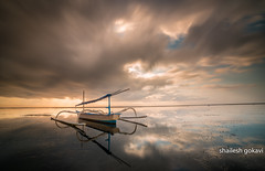 Clouds welcome a sunrise (segokavi) Tags: pantaikarang bali sunrise clouds motion water beach sea boat sanur