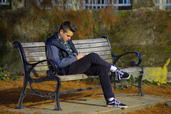 Bench Warming (swong95765) Tags: man guy bench seated park studying reading young handsome cleancut