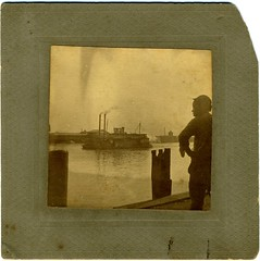 Man In Silhouette, Harbor, Steamboat, Brunswick, Georgia, Circa 1908 (mrwaterslide) Tags: man hat georgia harbor moody smoke brunswick smokestack wharf africanamerican steamboat shilouette evocative
