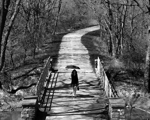 Woman on Sauk Trail Bridge #4 by PubCulture.