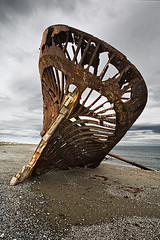 Left to the Elements (Chicken) Tags: chile beach wooden sand ship overcast shipwreck getty ambassador wreck stranded gravel clipper sceleton straitofmagellan
