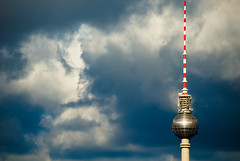 TV tower I (manganite) Tags: windows sky sunlight reflection berlin topf25 clouds digital buildings germany geotagged nikon colorful europe cross cloudy tl towers dramatic atmosphere alexanderplatz fernsehturm d200 nikkor dslr mitte televisiontower tvtowers 18200mmf3556 utatafeature manganite nikonstunninggallery ipernity challengeyou challengeyouwinner date:year=2007 spittinshells geo:lat=52509691 geo:lon=13377442 tvtowerset date:month=april date:day=6 stadtgetty2010