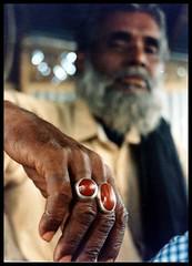 Hands of life... Rings with Stone [ Bosila Dhaka Bangladesh] (Saud A Faisal) Tags: life travel portrait canon asia hand lifestyle oldman experience ttl dslr bengal bangladesh digitalslr bangla bengali southasia bangladeshi subcontinent wrinkel throughthelensbangladesh saudafaisal