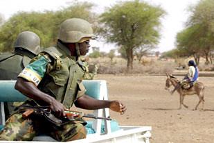 African Union troops patrolling the Darfur region of Sudan. At least ten AU peacekeepers were killed by Darfur rebels on Sunday, September 30, 2007.