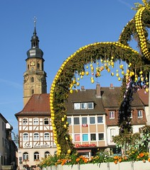 The market place and the church and the pub (:Linda:) Tags: roof sky flower clock church fountain sign architecture germany easter bavaria town ast cross timber balcony fenster shingle
