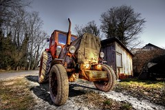 friendly tractor (gari.baldi) Tags: old tractor tree canon germany landscape 350d rusty gimp wideangle garibaldi hdr usedom 2007 lightroom trecker paperwall mecklenburgwesternpomerania photomatix sigma1020 splendiferous 1xp abigfave klpinsee