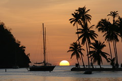 Marigot bay sunset, St Lucia, West Indies (Fanny Reno) Tags: sunset sea sky sun beach water bay stock carribean stlucia indies westindies saintlucia shutterstock